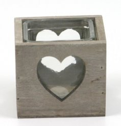 Glass candle holder in a wooden heart cutout tray