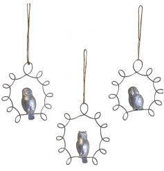 Silver hanging owl decoration set within a frame with jute string to hang.