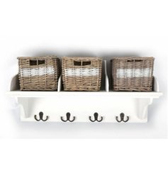 A country chic white wooden storage unit with natural and white wicker basket and 4 iron hooks.