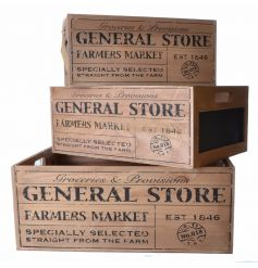 A set of rustic wooden General Store crates with Farmers Market lettering and a chalkboard sign.