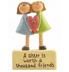 A lovely ornament and sign reading 'a sister is worth a thousand friends'