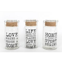 An assortment of glass jars with rope detail and love, life and home slogans.
