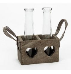 Two glass vases in a rustic wooden tray with heart cut out