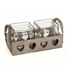 Square glass candle pots in a rustic wooden tray with heart cut outs