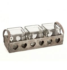 Triple candle holders in a wooden rustic tray with heart cut out detail