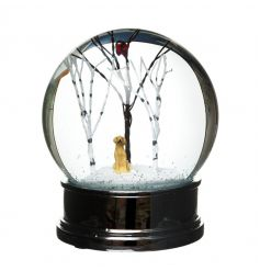 A beautiful and unique large snow globe with a festive winter scene and golden labrador.