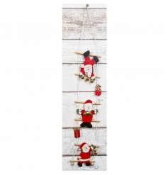 Hanging Santa on ladder decoration by RJB Stone