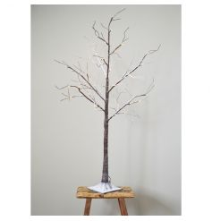A pretty LED light up twig tree with a festive snowy finish