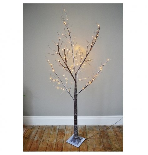A fine quality rustic LED twig tree with snow dusted branches. Each branch can be manipulated into shape
