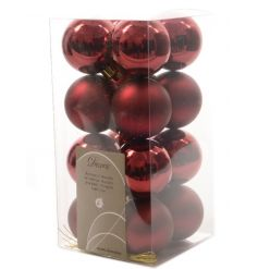 An assortment of glossy and matt oxblood red baubles