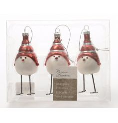 A pack of charming glass birds with long legs and red festive hats.