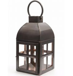 Decorative lantern in a rustic design finished in a trendy copper