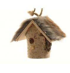 A rustic hanging bird house decoration with a quirky and stylish faux fur roof.