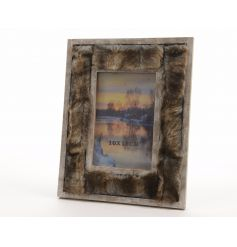 A stunning wooden photo frame with brown and gold faux fur.