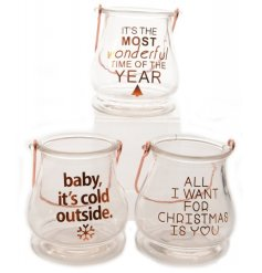 An assortment of 3 chic candle holders with copper festive slogans and handles.