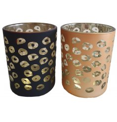 A chic and stylish mix of glass tlight holders featuring a gold and black painted decal