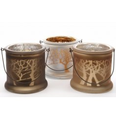 Matt glass lanterns with a laser woodland design and wire handles to hang.