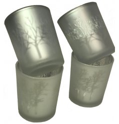 A mix of beautiful glass t-light holders with a stunning copper tree design.