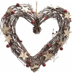 A heart shaped twig wreath with a glitter finish, rustic stars and red berries.