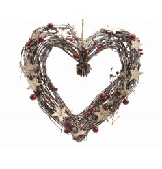 A rustic heart shaped twig wreath with a glitter finish, rustic stars and red berries.