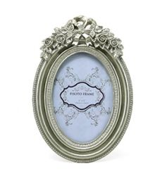 Oval shaped picture frame in a champagne colour