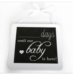 Shabby and chic countdown chalk board hung with a white ribbon