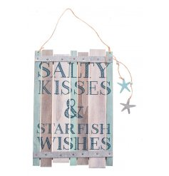Wooden plaque from Heaven Sends with beach quote and hanging decorations