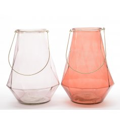 An assortment of 2 glass candle holders in trendy colours