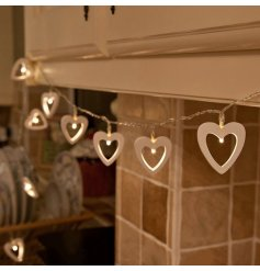 Wooden heart decorations on a string of LED lights