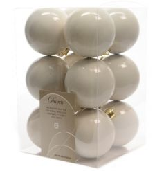 A box of 12 white wool coloured baubles with gold.