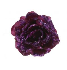 A luxurious purple rose on a clip with glitter and sequin embellishments.