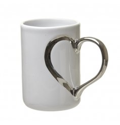 White china mug with sweet silver heart shaped handle