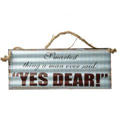 A rustic corrugated metal sign with a humorous Yes Dear! slogan.
