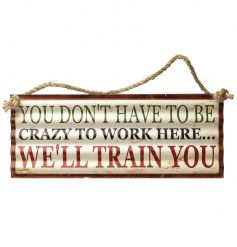 A humorous metal corrugated sign with a distressed finish.