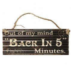 A humorous vintage metal sign with a distressed finish and chunky jute rope to hang