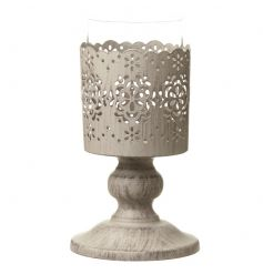 A wooden based candle holder with metal holder with cut out flower design and glass centre