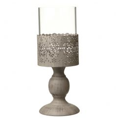 A stylish glass and metal candle holder with a decorative floral pattern.