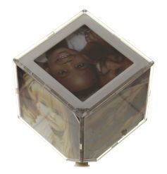 A small photo cube which holds 6 prints and spins from the base on an angle creating a floating effect