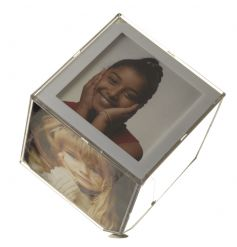 A large photo cube which holds 6 prints and spins from the base on an angle creating a floating effect