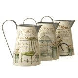 An assortment of chic antique metal jugs with a pretty flea market design.