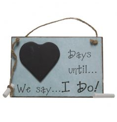 A shabby chic wooden wedding countdown sign with a chalkboard heart