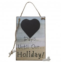 A coastal themed wooden holiday countdown sign with a heart chalkboard and hanging chalk