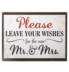 A vintage metal sign with a distressed finish, the perfect accessory to be placed alongside a guestbook at a wedding