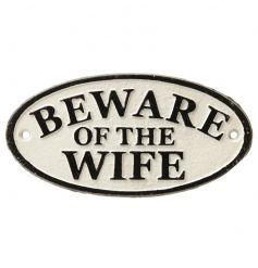 A cream and black cast iron sign with funny Wife Phrase