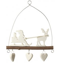 Hanging wooden Christmas scene with decorative heart detail