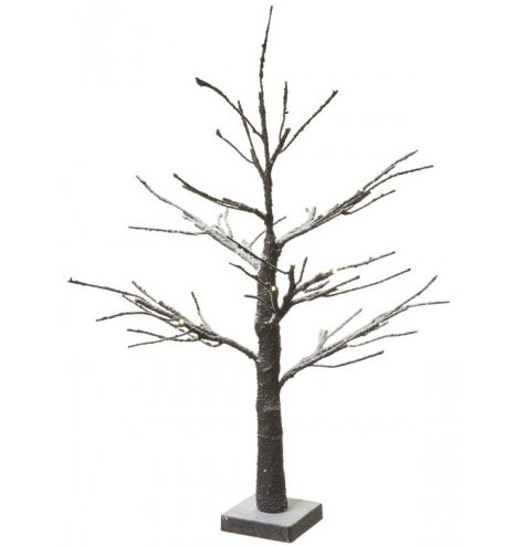 A table top sized brown twig tree with a snow dusted finish. The branches can be bent and manipulated into place