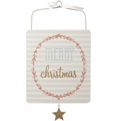 A pretty pastel coloured MERRY CHRISTMAS wooden sign with decorative patterns.
