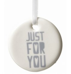 A white and silver ceramic decoration 'Just For You' with hearts.