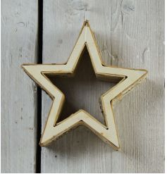 A stylish chunky star decoration made from wood with birch detailing.
