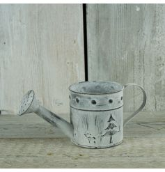 Zinc watering can in a whitewashed design with festive images